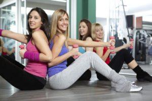 Toned women exercising