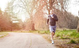 man jogging outside on- 5 tips when starting your weight loss journey