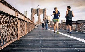 Fitness-Hacks-For-Busy-People---couple-running-on-a-bridge