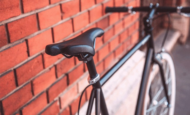 Fitness-Hacks-For-Busy-bike against a wall
